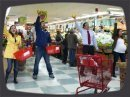 For our latest mission, six undercover actors burst into song in a grocery store in Queens. Three minutes and lots of silly choreography later, they returned to their roles as shoppers and stock boys. The mission was filmed with hidden robotic, lipstick, and wearable cameras. The song was played over the store's PA system live.