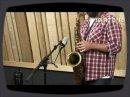 Enregistrement d'un saxophone à l'aide du micro Neumann TLM 102.